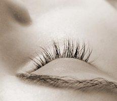 The closed eye of someone asleep